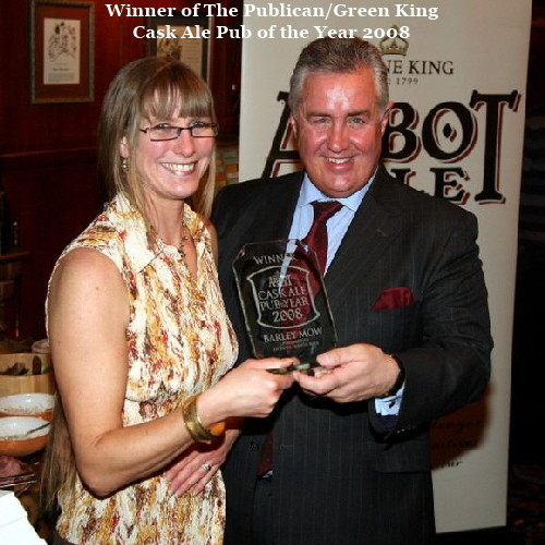Judi is presented with her award by Greene King Brewing Company sales director Greg Williams